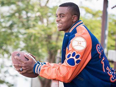 orange and blue letter jacket